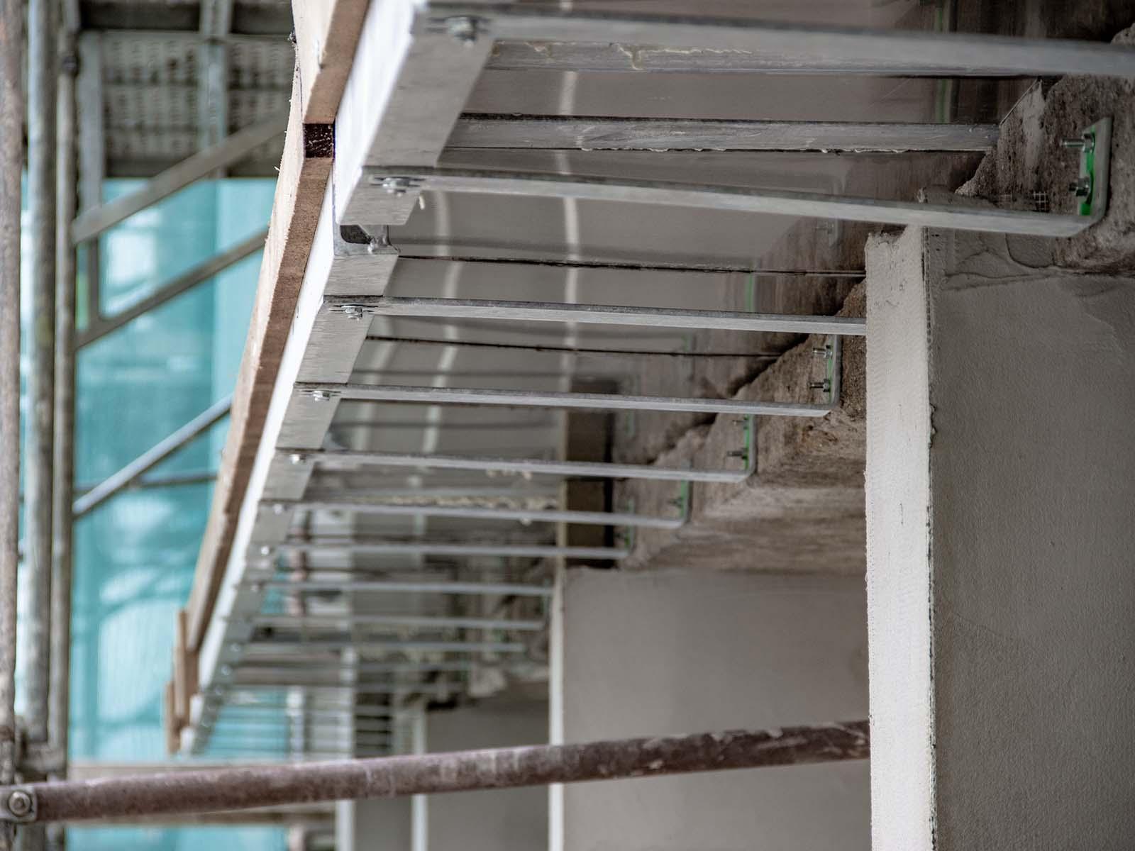 Rekonstrukce bytového domu Tišnov - zateplení, zvětšení lodžií, nové rozvody eletro, vody a kanalizace